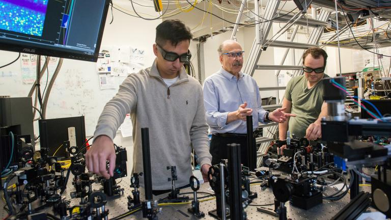 University of Chicago researcher David D. Awschalom in his lab with Ph.D. students Kevin Miao, left, and Alexandre Bourassa, on Oct. 15, 2018. (Photo by Jean Lachat)