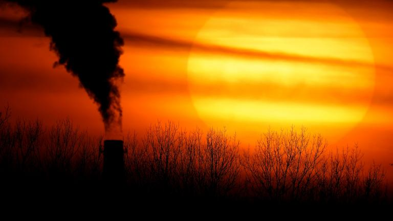 In this Monday, Feb. 1, 2021 file photo, emissions from a coal-fired power plant are silhouetted against the setting sun in Independence, Mo. (AP Photo / Charlie Riedel)