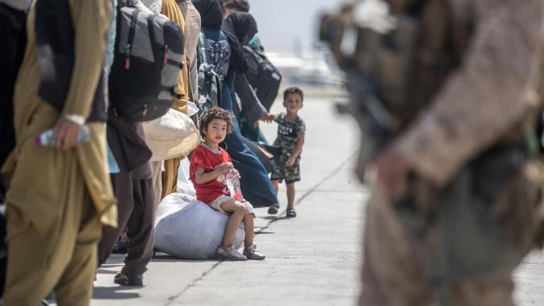 In this Aug. 22, 2021, image provided by the U.S. Marine Corps, a child waits with her family to board a U.S. Air Force Boeing C-17 Globemaster III during an evacuation at Hamid Karzai International Airport in Kabul, Afghanistan. (Sgt. Samuel Ruiz/U.S. Marine Corps via AP)