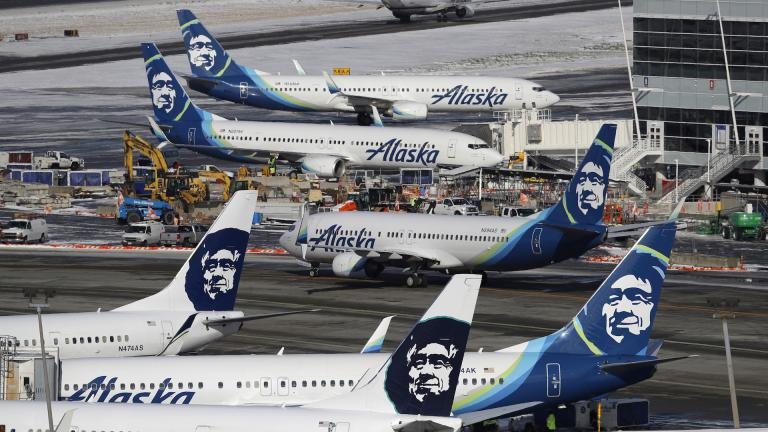 In this Feb. 5, 2019, file photo, Alaska Airlines planes are parked at a gate area at Seattle-Tacoma International Airport in Seattle. Alaska Airlines said over 300 employees among the company's workforce in Anchorage may lose their jobs on Oct. 1, 2020. (AP Photo/Ted S. Warren, File)