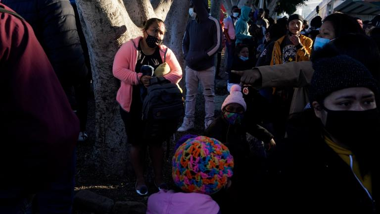 In this Feb. 19, 2021 file photo, a woman seeking asylum in the United States waits with others for news of policy changes, in Tijuana, Mexico. (AP Photo / Gregory Bull, File)
