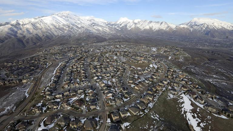 FILE - Rows of homes, in suburban Salt Lake City, on April 13, 2019. Utah is one of two Western states known for rugged landscapes and wide-open spaces that are bucking the trend of sluggish U.S. population growth. (AP Photo / Rick Bowmer, File)