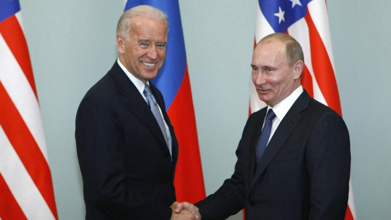 In this March 10, 2011, file photo, then-Vice President Joe Biden, left, shakes hands with Russian Prime Minister Vladimir Putin in Moscow, Russia. (AP Photo / Alexander Zemlianichenko, File)