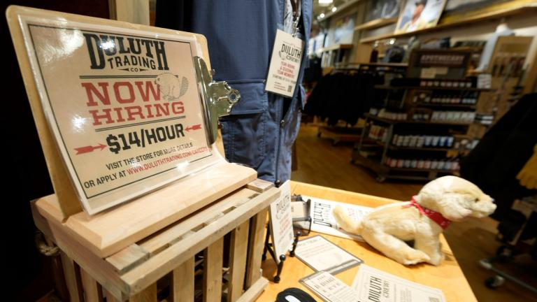 A now hiring sign sits on a display in a clothing store Saturday, Oct. 9, 2021, in Sioux Falls, S.D. (AP Photo /vDavid Zalubowski)