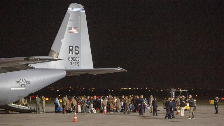 FILE - In this Aug. 29, 2021, file photo families evacuated from Kabul, Afghanistan, walk past a U.S Air Force plane that they arrived on at Kosovo's capital Pristina International Airport. (AP Photo / Visar Kryeziu, File)