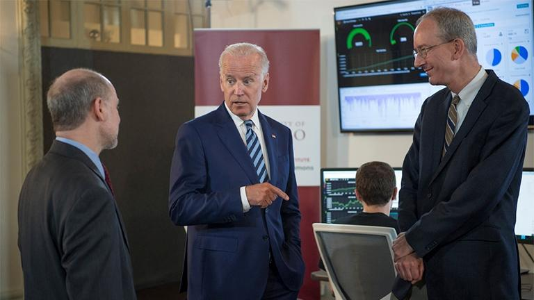 Vice President Joe Biden talks with professor Robert Grossman, director of Center for Data Intensive Science at the University of Chicago, and Louis M. Staudt of the National Cancer Institute as they tour the Genomic Data Commons on June 6. (Robert Kozloff)