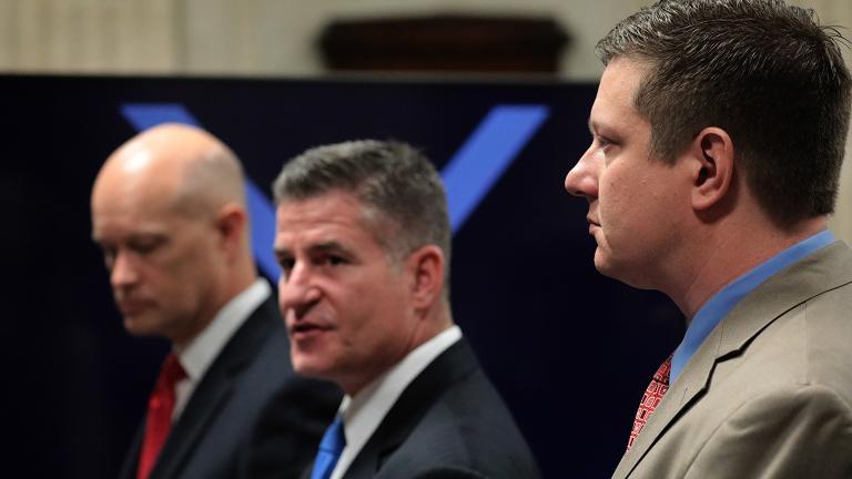 From left: Prosecutor Joseph McMahon, defense attorney Daniel Herbert and Jason Van Dyke approach the judge's bench on Thursday, Oct. 4, 2018. (Antonio Perez / Chicago Tribune / Pool)