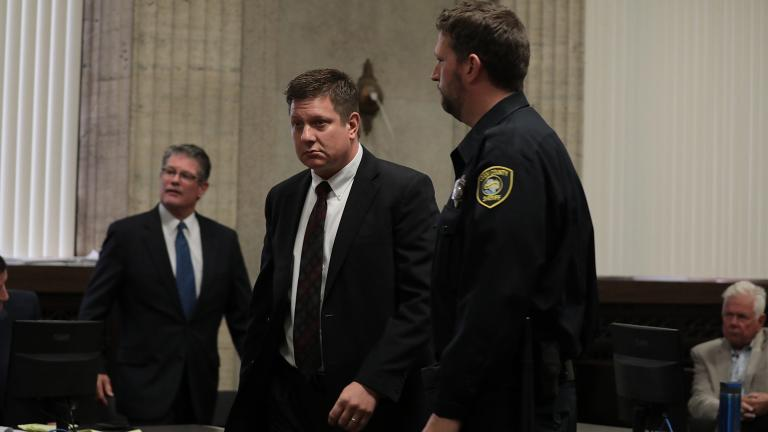 Sheriff's deputies escort Chicago police Officer Jason Van Dyke from the courtroom Thursday, Sept. 6, 2018, after Judge Vincent Gaughan's ruling that ordered Van Dyke's bail be raised only slightly for giving an interview to the Chicago Tribune and a local TV station just days before jury selection was set to begin in his murder trial. (Antonio Perez / Chicago Tribune / Pool)
