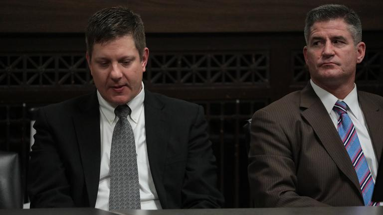 Chicago police Officer Jason Van Dyke, left, reacts to the verdict on Friday, Oct. 5, 2018. His lead attorney, Daniel Herbert, sits beside him. (Antonio Perez / Chicago Tribune / Pool)