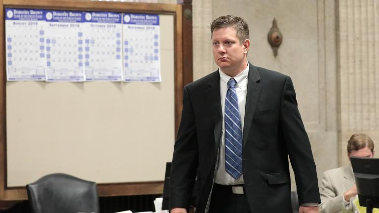 Chicago police Officer Jason Van Dyke approaches the judge's bench at a hearing for the shooting death of Laquan McDonald, at the Leighton Criminal Court Building on Wednesday, Aug. 15, 2018. (Antonio Perez / Chicago Tribune / Pool)