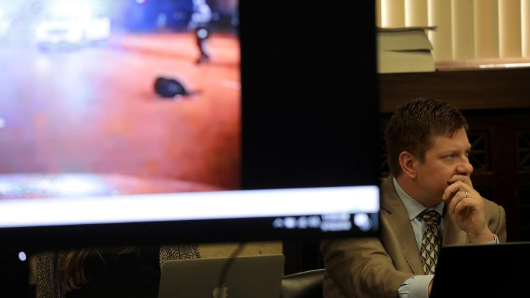 Chicago police Officer Jason Van Dyke listens in as an image showing the shooting death of Laquan McDonald is displayed during the trial on Tuesday, Sept. 18, 2018. (Antonio Perez / Chicago Tribune / Pool)