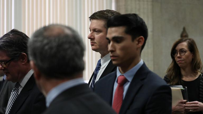 Chicago police Officer Jason Van Dyke, foreground, stands in front of Judge Vincent Gaughan at the Leighton Criminal Court Building in Chicago on Wednesday, March 28, 2018. (Nancy Stone / Chicago Tribune / Pool)