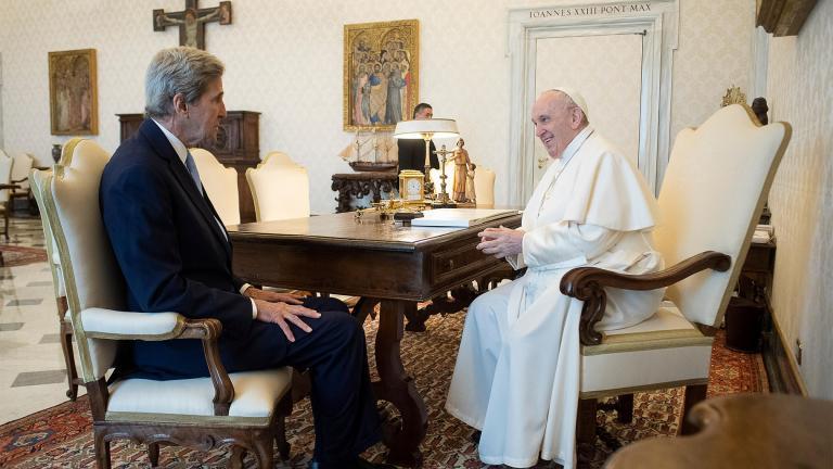 Pope Francis and John Kerry talk during their meeting at the Vatican, Saturday, May 15, 2021. (Vatican Media via AP)