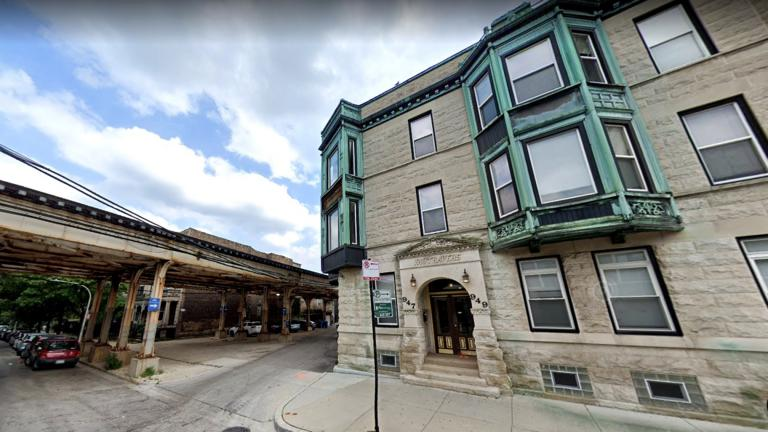 The CTA's Red-Purple tracks have curved around the Vautravers Building in Lakeview for a century. The agency moved the building to straighten the kink in the system. (Credit: Google Street View)