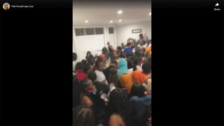 A screenshot taken from a Facebook Live video shows a crowded house party that appears to have been held in Chicago on Saturday, April 25, 2020.
