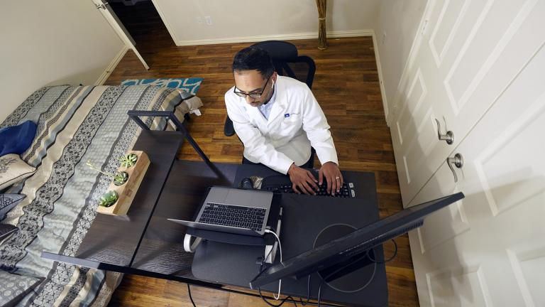 Medical director of Doctor on Demand Dr. Vibin Roy types notes as he listens to a patient during an online primary care visit from his home, Friday, April 23, 2021, in Keller, Texas. (AP Photo / LM Otero)