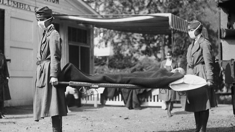 This photo made available by the Library of Congress shows a demonstration at the Red Cross Emergency Ambulance Station in Washington during the influenza pandemic of 1918. (Library of Congress via AP, File)