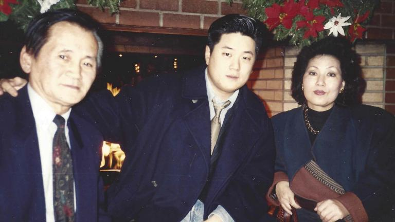 In this undated photo provided by Charlton Rhee, Rhee, a nursing home administrator from New York, poses for a photo with his parents, Man Joon Rhee and Eulja Rhee. Charlton Rhee, whose parents came to the U.S. from South Korea, lost both of them to COVID-19 as the virus surged in New York City.  (Courtesy of Charlton Rhee via AP)