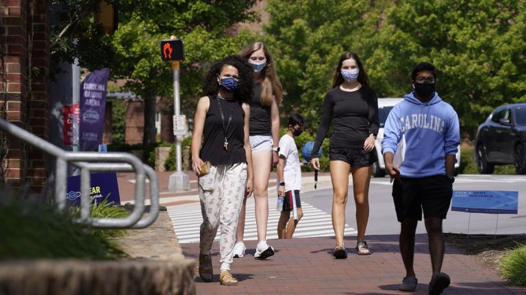 In this Aug. 18, 2020, file photo, students wear masks on campus at the University of North Carolina in Chapel Hill, N.C. (AP Photo/Gerry Broome, File)