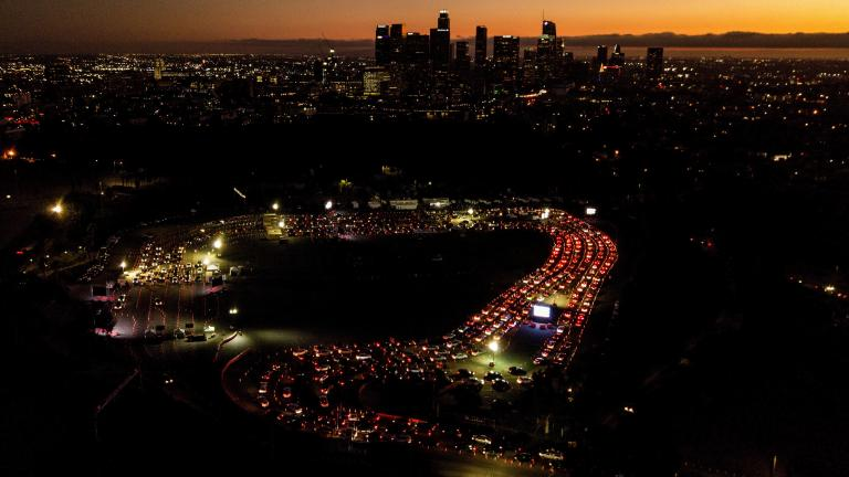 In this Nov 18, 2020, file photo, motorists wait in long lines to take a coronavirus test in a parking lot at Dodger Stadium in Los Angeles. (AP Photo/Ringo H.W. Chiu, File)