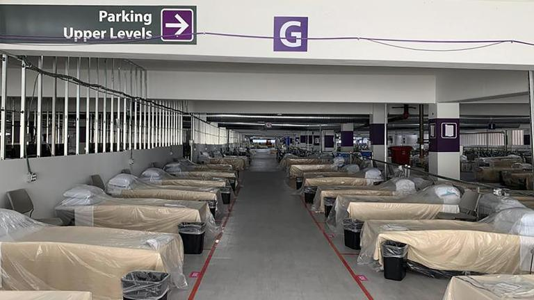 Hospital beds sit inside Renown Regional Medical Center's parking garage, which has been transformed into an alternative care site for COVID-19 patients in Reno, Nev., on Wednesday, Nov. 11, 2020. (Lucia Starbuck / KUNR Public Radio / Report for America via AP)