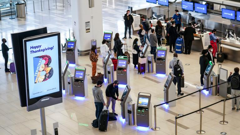 In this Nov. 25, 2020, file photo, travelers wait to check-in for their flights ahead of Thanksgiving at LaGuardia Airport, in the Queens borough of New York. (AP Photo / John Minchillo, File)