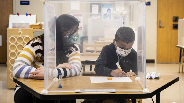 In this Jan. 11, 2021 file photo, pre-kindergarten teacher Sarah McCarthy works with a student at Dawes Elementary in Chicago. (Ashlee Rezin Garcia / Chicago Sun-Times via AP, Pool, File)