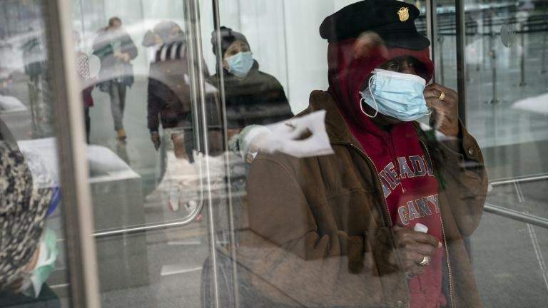 In this Feb. 3, 2021, file photo, a patient adjusts his face mask as he leaves a COVID-19 vaccination site inside the Jacob K. Javits Convention Center in New York. (AP Photo/John Minchillo, File)