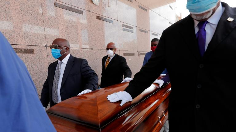 In this April 22, 2020, file photo, pallbearers, who were among only 10 allowed mourners, walk the casket for internment at the funeral for Larry Hammond, who died from the coronavirus, at Mount Olivet Cemetery in New Orleans. (AP Photo / Gerald Herbert, File)