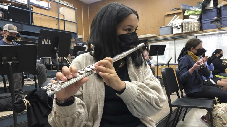 FILE - In this March 2, 2021 file photo, a student plays the flute while wearing a protective face mask during a music class at the Sinaloa Middle School in Novato, Calif. (AP Photo / Haven Daily)