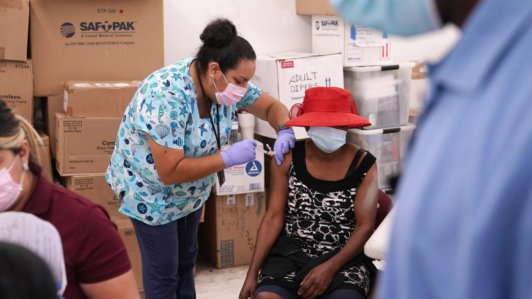 In this April 10, 2021, file photo, registered nurse Ashleigh Velasco, left, administers the Johnson & Johnson COVID-19 vaccine to Rosemene Lordeus, right, at a clinic held by Healthcare Network in Immokalee, Fla. (AP Photo / Lynne Sladky, File)