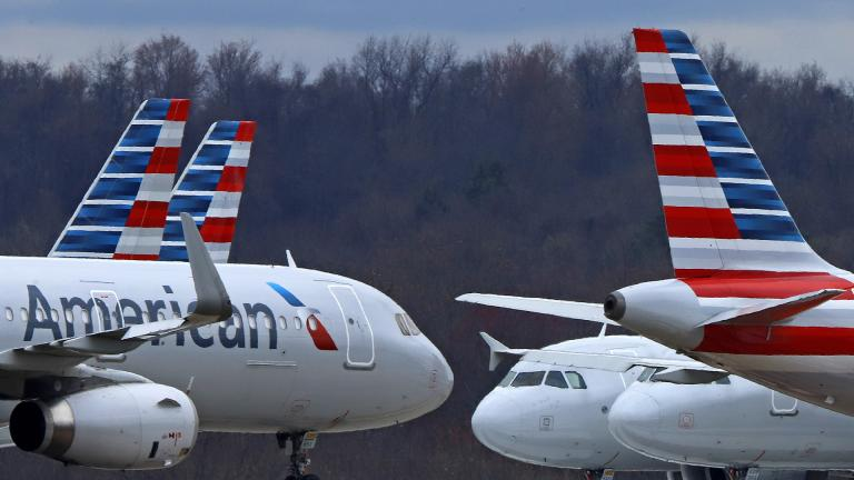 In this March 31, 2020 file photo American Airlines planes are parked at Pittsburgh International Airport in Imperial, Pa. (AP Photo / Gene J. Puskar, file)
