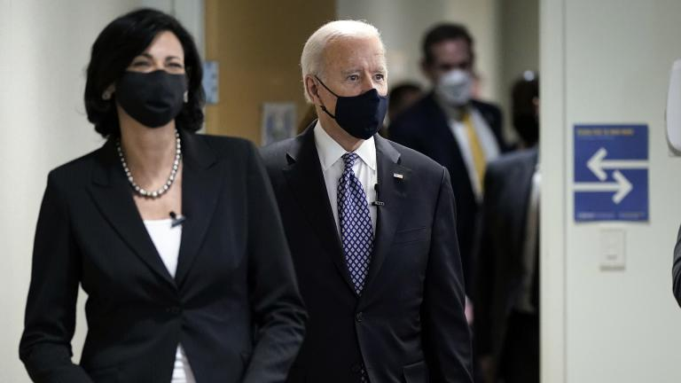 In this March 19, 2021, photo, Dr. Rochelle Walensky, director of the Centers for Disease Control and Prevention, leads President Joe Biden into the room for a COVID-19 briefing at the headquarters for the CDC Atlanta. (AP Photo / Patrick Semansky)