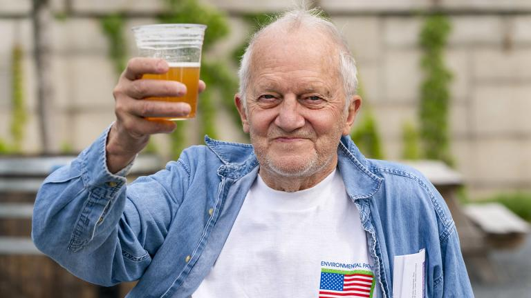 In this May 6, 2021 photo, George Ripley, 72, of Washington, holds up his free beer after receiving the J&J COVID-19 vaccine shot, at The REACH at the Kennedy Center in Washington. (AP Photo / Jacquelyn Martin)