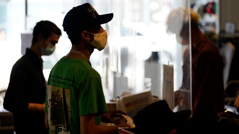 In this July 19 2021 file photo, employees check out customers at 2nd Street second hand store in the Fairfax district of Los Angeles. (AP Photo / Marcio Jose Sanchez, File)