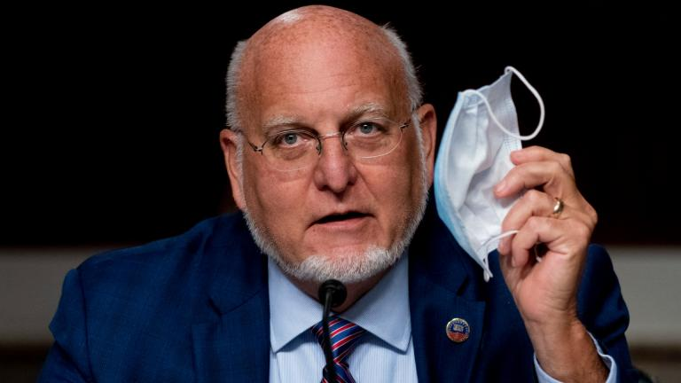 "Centers for Disease Control and Prevention Director Dr. Robert Redfield holds up his mask as he speaks at a Senate Appropriations subcommittee hearing on a ""Review of Coronavirus Response Efforts"" on Capitol Hill, Wednesday, Sept. 16, 2020, in Washington. (AP Photo / Andrew Harnik, Pool)"