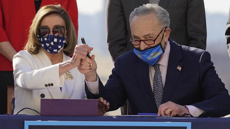 House Speaker Nancy Pelosi of Calif., and Senate Majority Leader Chuck Schumer of N.Y., pose after signing the $1.9 trillion COVID-19 relief bill during an enrollment ceremony on Capitol Hill, Wednesday, March 10, 2021, in Washington. (AP Photo / Alex Brandon)