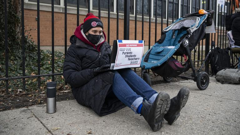In this Jan. 11, 2021 file photo, a Suder Montessori Magnet Elementary School teacher speaks to students during a virtual class outside of the school in solidarity with pre-K educators forced back into the building in Chicago. (Anthony Vazquez / Chicago Sun-Times via AP, File)