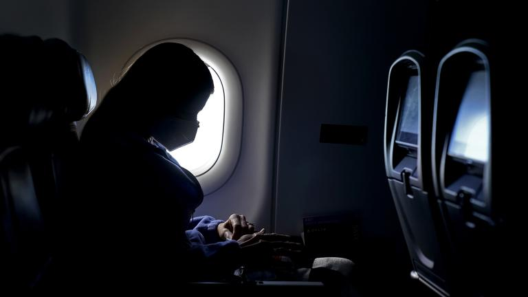 In this Wednesday, Feb. 3, 2021, file photo, a passenger wears a face mask she travels on a flight from Hartsfield-Jackson International Airport in Atlanta. (AP Photo / Charlie Riedel, File)