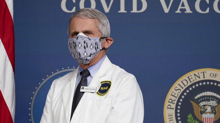In this Feb. 25, 2021, Dr. Anthony Fauci, director of the National Institute of Allergy and Infectious Diseases, listens as President Joe Biden speaks during an event to commemorate the 50 millionth COVID-19 shot in Washington. (AP Photo / Evan Vucci, File)