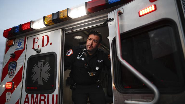"In this April 23, 2020, photo FDNY paramedic Alex Tull, who has recently recovered from COVID-19, prepares to begin his shift outside EMS station 26, the ""Tinhouse"", in the Bronx borough of New York. (AP Photo / John Minchillo)"