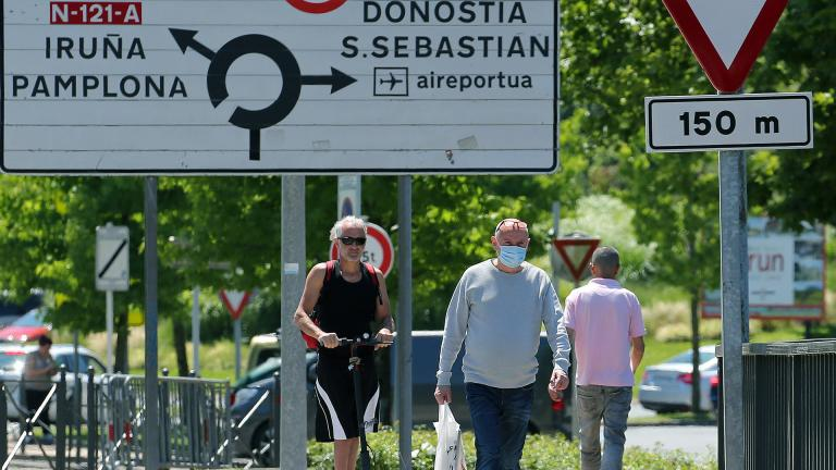 People cross the border between France and Spain at Behobie, southwestern France, Sunday, June 21, 2020. Spain reopened its borders to European tourists Sunday in a bid to kickstart its economy while Brazil and South Africa struggled with rising coronavirus infections. (AP Photo / Bob Edme)