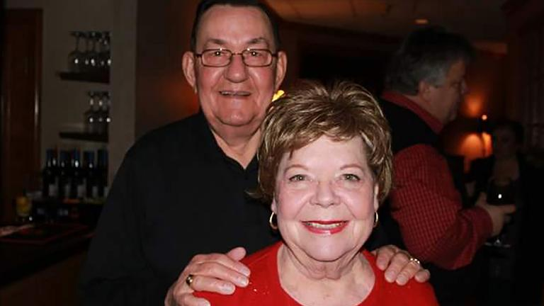 In this 2011 family photo provided by Dawn Bouska, Charles Recka and his wife, Patricia Recka, pose for a photo at a banquet in Naperville, Illinois. Charles Recka died on March 12, 2020. (Courtesy of Dawn Bouska via AP)