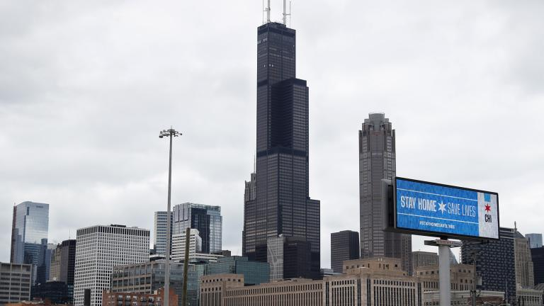 A public service message reading Stay Home Saves Lives is seen against the Chicago skyline Monday, March 30, 2020. (AP Photo/ Charles Rex Arbogast)