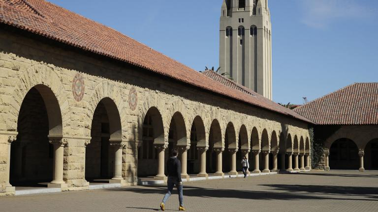 In this March 14, 2019, file photo, people walk on the Stanford University campus beneath Hoover Tower in Stanford, Calif. (AP Photo / Ben Margot, File)