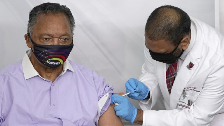 In this Friday, Jan. 8, 2021 file photo, Rev. Jesse Jackson receives the Pfizer's BioNTech COVID-19 vaccine from Dr. Kiran Chekka, Covid Administration Physician at the Roseland Community Hospital in Chicago. (AP Photo / Charles Rex Arbogast, File)