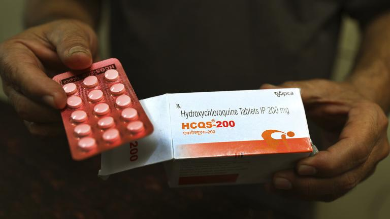 In this April 9, 2020 file photo, a chemist displays hydroxychloroquine tablets in New Delhi, India. (AP Photo / Manish Swarup, File)