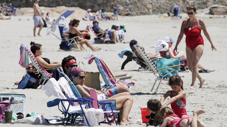Beachgoers relax on the shore at Good Harbor Beach in Gloucester, Mass., Friday, May 22, 2020. Beaches in Gloucester reopened with restrictions on Friday after being closed two months ago due to the pandemic. (AP Photo / Charles Krupa)