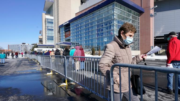 People enter a socially distanced line to get their COVID-19 vaccinations at Gillette Stadium, Monday, Feb. 8, 2021, in Foxborough, Mass. (AP Photo / Steven Senne)