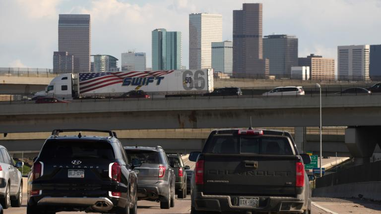 In this May 27, 2021 file photo, vehicles move along southbound Interstate 25 while motorists sit on the Interstate 70 overpass to start the Memorial Day weekend in Denver. (AP Photo / David Zalubowski)
